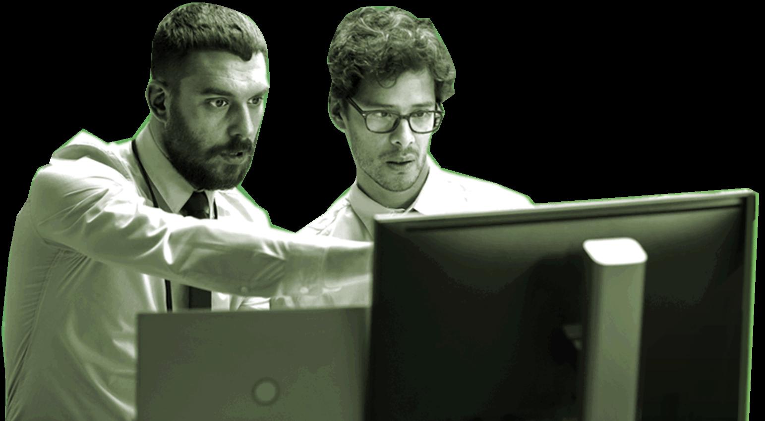 2 guys looking at a computer monitor